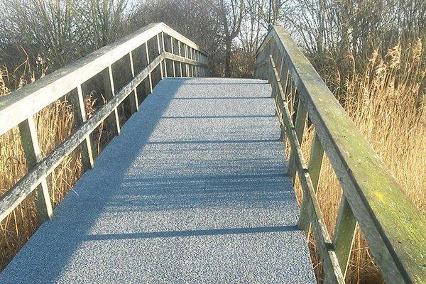 Kiezelmat voor loopbrug antislip brug